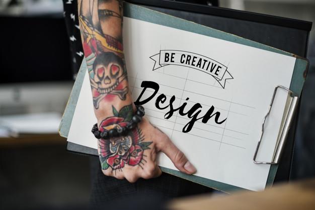 Fashion designer holding a clipboard